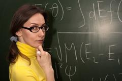 Woman professor or student chalk board Stock Photos