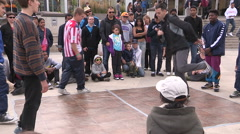 Hip hop break dance competition in urban centre streets Stock Footage