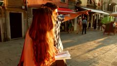 Italy Vacation Woman Asking man for Directions Sun Flare Travel Concept Stock Footage