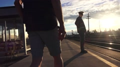 Train depot, commuter meet Stock Footage