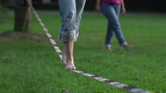 Girl on a slack line Stock Footage