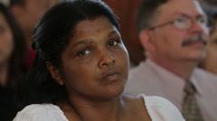 Woman Listens to Sermon in Church in Cuba - stock footage