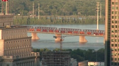 Cityscape - Bridge with cars and train over water on sunny day Stock Footage