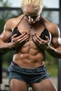 female bodybuilder showing abs - stock photo