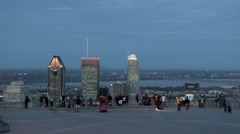 Cityscape - Wide angle shot of people overlooking buildings at dusk Stock Footage