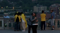 Cityscape - Couple man & woman hugging on viewing deck Stock Footage