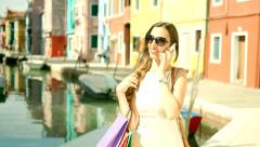 Beautiful Business Woman Shopping in Italy Talking Smartphone Stock Footage