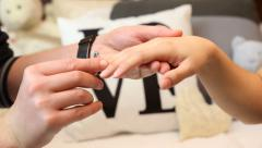 Fiance putting ring on fiancee finger.FULL HD Stock Footage