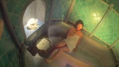 Woman relaxing in steam bath Stock Footage