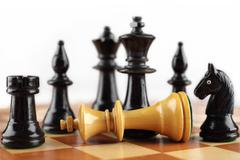Chess concept. Checkmate white king. Stock Photos