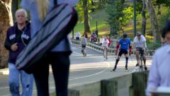 RUNNERS BIKES CARS INLINE SKATER IN CENTRAL PARK01 Stock Footage