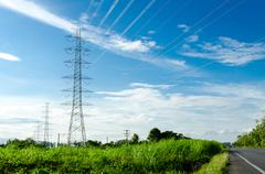 High voltage post or high voltage tower in green field Stock Photos
