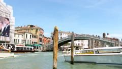 VENICE, ITALY - CIRCA 2014: Boats with Tourists on Vacation Pass under Bridge. Stock Footage
