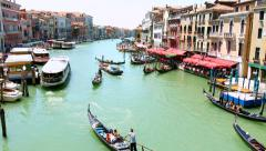 VENICE, ITALY - CIRCA 2014: Boats Pass Rialto Bridge on Grand Canal. Stock Footage