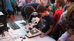 Kids and parents examine marine biological specimens, instruments and tools - stock footage