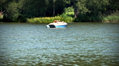 Couple with boat on a lake Stock Footage