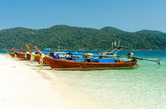 Thai wooden boats at adang-rawi island near koh lipe in satun, thailand Stock Photos