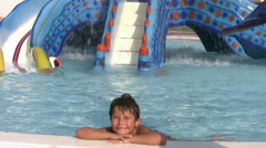 Child in aqua park smiling to a camera Stock Footage
