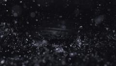 Heavy rain into puddle, Slow Motion Arkistovideo