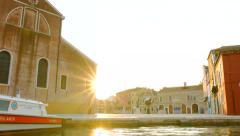VENICE, ITALY - CIRCA 2014: Sun shining on Venetian square as people pass by. Stock Footage