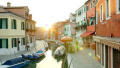 VENICE, ITALY - CIRCA 2014: Beautiful small Street of Burano during Sunset. Stock Footage