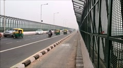 Heavy traffic passes on Yamuna Bridge New Delhi/Time-lapse Stock Footage