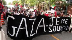 Stock Video Footage of Mass of protesters holding GAZA sign