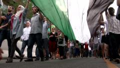 View under large Palestine flag during protest Stock Footage