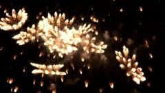 Bright fireworks exploding within full frame Stock Footage