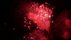 Red sparkle fireworks detonating up high Stock Footage