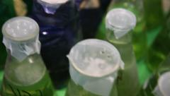 Lab bottles on shaker shake liquid microbial biological culture Stock Footage