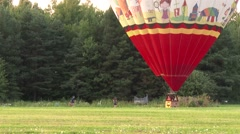 Staff running towards large hot-air balloon Arkistovideo