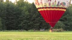 Staff running towards large hot-air balloon Stock Footage