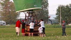 Hot air balloon discussing around basket at dawn Stock Footage