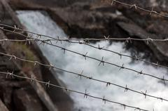 hydroelectric barbed wire - stock photo