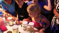 Kids and parents examine marine biological specimens, instruments and tools Stock Footage