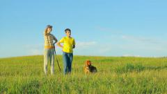 Kids and dog looking ahead in the field in the evening, childhood, future Stock Footage