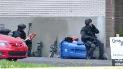SWAT officer taking lunch break during standoff with riffle Stock Footage