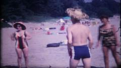 1168 - family on vacation has beach ball fun - vintage film home movie Stock Footage