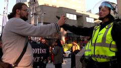 Protester filming riot officer too close Stock Footage