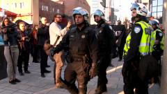 Riot police arriving at scene of protest Stock Footage
