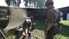 US Soldiers prepare coffee in front of glider - stock footage