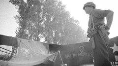 Soldier cooking on military basecamp with glider on background Stock Footage
