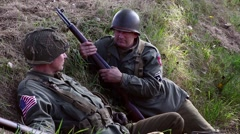 American Soldiers sitting in tranch - stock footage