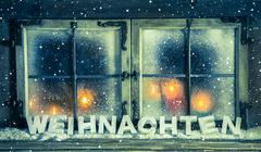 atmospheric xmas window for a background with german text: christmas. - stock photo