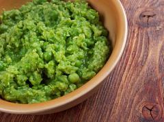 bowl of mushy peas, - stock photo