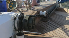 Anchor chain into the boat - stock footage