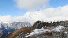Movement of the clouds on the mountains Kongde Ri, Himalayas, Nepal. FULL HD Stock Footage