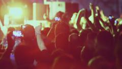 Concert people big crowd fans hands in the air camera pan 013 Stock Footage