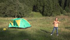 4K Happy Child Playing Looking Camera, Smiley Little Girl Making Sport, Camping Stock Footage